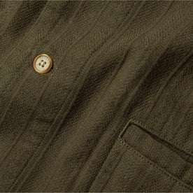 material shot of chest pocket and button