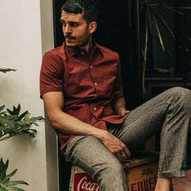 fit model wearing The Havana in Rusted Floral Jacquard, sitting on box