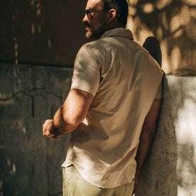 fit model wearing The Short Sleeve Officer Shirt in Khaki, back shot