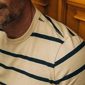 fit model wearing The Organic Cotton Tee in Khaki Stripe, shoulder detail