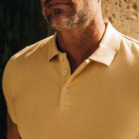 fit model wearing The Pique Polo in Straw, chest close up