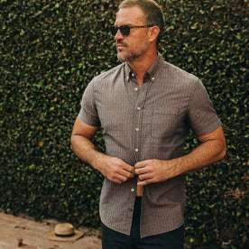 fit model wearing The Short Sleeve Jack in Cocoa Dobby, slightly unbuttoned by pool