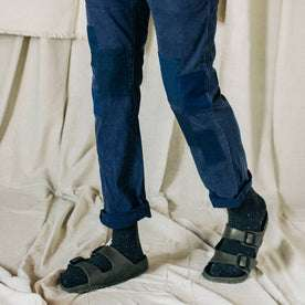material shot of The Atelier and Repairs Chino in Navy, model standing diagonal