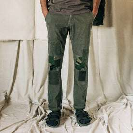 material shot of The Atelier and Repairs Chino in Olive, cuffed on model