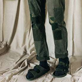 material shot of The Atelier and Repairs Chino in Olive, model standing diagonal