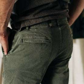 material shot of The Atelier and Repairs Chino in Olive, side shot on model