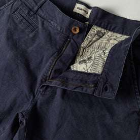 material shot of The Atelier and Repairs Chino in Navy, fly shot
