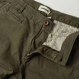 material shot of The Atelier and Repairs Chino in Olive, fly shot