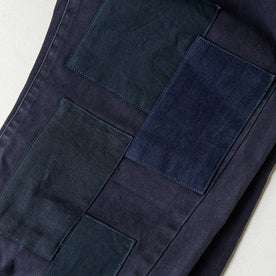 material shot of The Atelier and Repairs Chino in Navy, patches on front