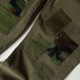 material shot of The Atelier and Repairs Chino in Olive, patches on front