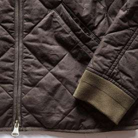 material shot of The Quilted Bomber Jacket in Espresso, front pocket and sleeve