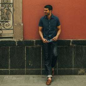 fit model wearing The Short Sleeve California in Indigo Jacquard Stripe, looking left of camera