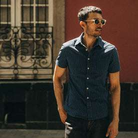 fit model wearing The Short Sleeve California in Indigo Jacquard Stripe, looking right of camera