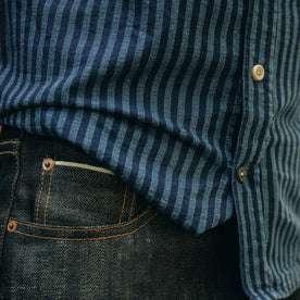 fit model wearing The Short Sleeve California in Indigo Jacquard Stripe, paired with dark denim