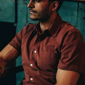 fit model wearing The Short Sleeve California in Rust Pique, sitting, chest crop