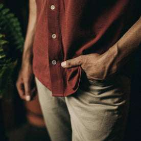 fit model wearing The Short Sleeve California in Rust Pique, hand in pocket