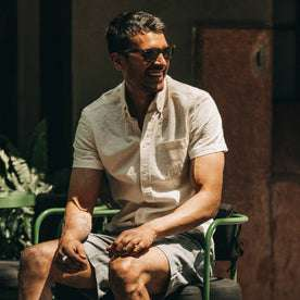 fit model wearing flatlay of The Short Sleeve Jack in Natural Ramie Grid, smiling, looking right