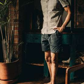 fit model wearing The Trail Short in Navy Reverse Sateen, hands in pockets