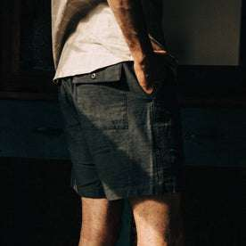 fit model wearing The Trail Short in Navy Reverse Sateen, right hand in pocket