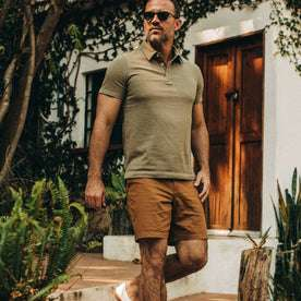 fit model wearing The Trail Short in Tobacco, walking right