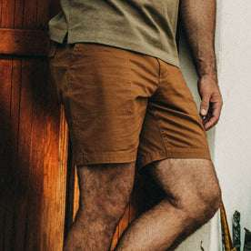 fit model wearing The Trail Short in Tobacco, cropped chest down