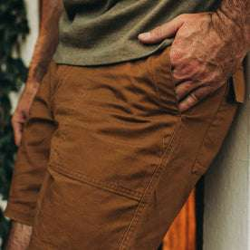 fit model wearing The Trail Short in Tobacco, hand in pocket