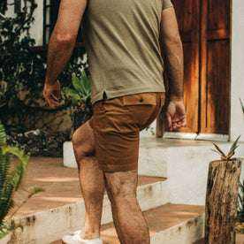 fit model wearing The Trail Short in Tobacco, back shot