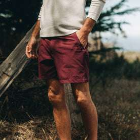 fit model wearing The Traverse Short in Wine, hand in pocket
