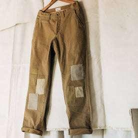 material shot of The Atelier and Repairs Chino in British Khaki, hanging in studio