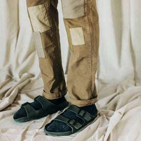 material shot of The Atelier and Repairs Chino in British Khaki, model wearing chinos with birks