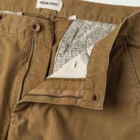 material shot of The Atelier and Repairs Chino in British Khaki, fly shot
