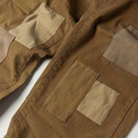 material shot of The Atelier and Repairs Chino in British Khaki, patches on front