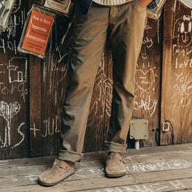 fit model wearing The Camp Pant in Stone Boss Duck, cuffed with birks