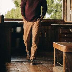 fit model wearing The Camp Pant in Tobacco Boss Duck, inside, walking