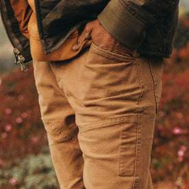 fit model wearing The Chore Pant in Tobacco Boss Duck, hand in pocket