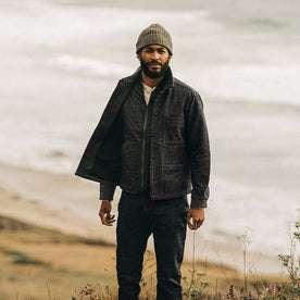 fit model wearing The Decker Jacket in Navy Wool Beach Cloth, standing near coast