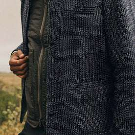 fit model wearing The Decker Jacket in Navy Wool Beach Cloth, hand holding jacket, up close shot