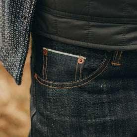 fit model wearing The Democratic Jean in Nihon Menpu Selvage, up close shot of pocket