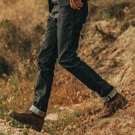 fit model wearing The Democratic Jean in Nihon Menpu Selvage, walking left