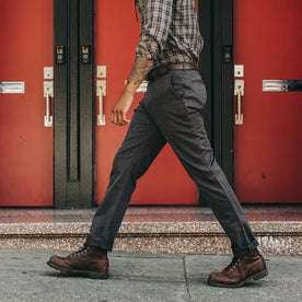 fit model wearing Foundation Pant, walking left