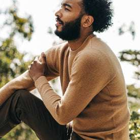 fit model wearing The Double Knit Sweater in British Khaki, sitting