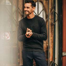 fit model wearing The Double Knit Sweater in Charcoal, hands clasped