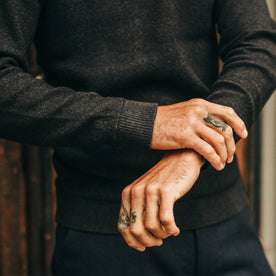 fit model wearing The Double Knit Sweater in Charcoal, sleeve detail