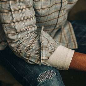 fit model wearing The Jack in Sky Plaid, cuffed over henley