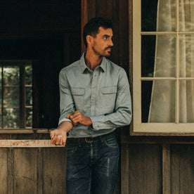 fit model wearing The Ledge Shirt in Sun Bleached Chambray, looking right