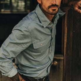 fit model wearing The Ledge Shirt in Sun Bleached Chambray, up close of sleeve