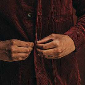 fit model wearing The Ojai Jacket in Burgundy Cord, buttoning jacket