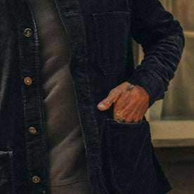 fit model wearing The Ojai Jacket in Midnight Cord, hand in pocket