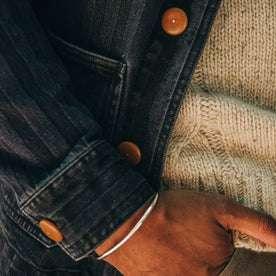 fit model wearing The Ojai Jacket in Washed Indigo Herringbone, sleeve shot, hand in pocket