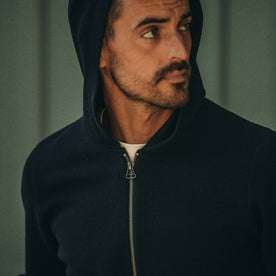 fit model wearing portola hoodie, looking right